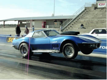 muscle car doing a wheelie